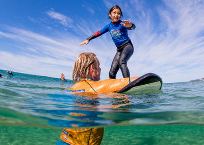Surfing Lessons - SurfGroms
